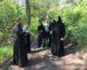 Отец Василиск провел гостей по экологической тропе дубового леса